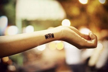 small_tattoo_placement_ideas_camera_wrist